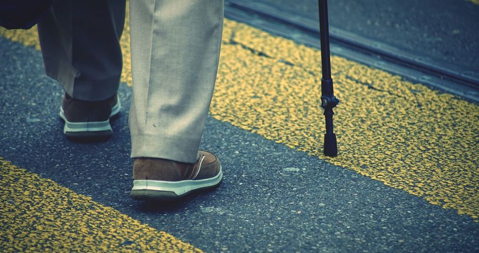 An old man Low Section Human Leg Real People Standing Shoe Men One Person Lifestyles Day Human Body Part Road Outdoors Close-up Adult The Art Of Street Photography