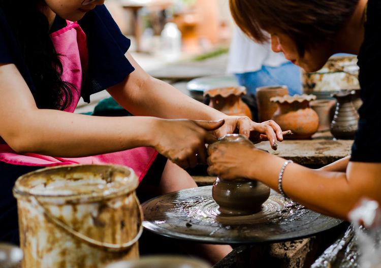 Women making pot in workshop