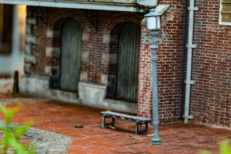 Architecture Built Structure Building Exterior Brick Brick Wall Wall Seat Bench No People Day Building City Outdoors Entrance Selective Focus Absence Street Door Window Footpath Park Bench
