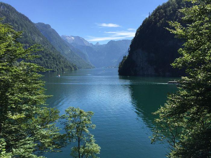 Calm lake against lush mountains