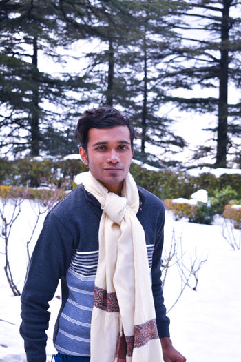 a young man in a snow covered park Clean Shaved Haircuts Mensfashion Menswear Sweater Scarf Fun Sexyboy Mensfashion Young Adult Young Men Park Warm Clothing Winter Fun Dslrphotography Shotonnikon Snow