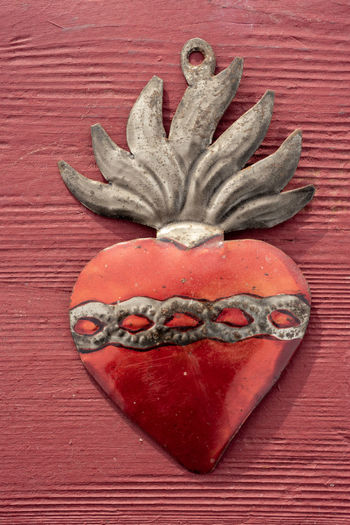 antique metal heart form with symbolic flames and chain made in Mexico Red No People Close-up Indoors  Directly Above Art And Craft Creativity Anthropomorphic Heart Shape Heart ❤ Hearts Antique Crafts Mexican Culture Metallic Metalwork Flames Chain Symbolic  Symbolism Valentine love is love Love ♥