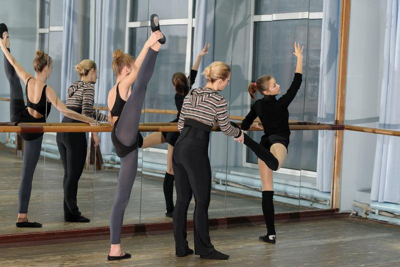 Ball-room Ballerina Ballet Ballet-dancer Barren Caucasian Choreograph Choreographer  Class Dance Dancer Girl Help Horizontal Mirror Position Practice Rehearsal Studio Teach Women