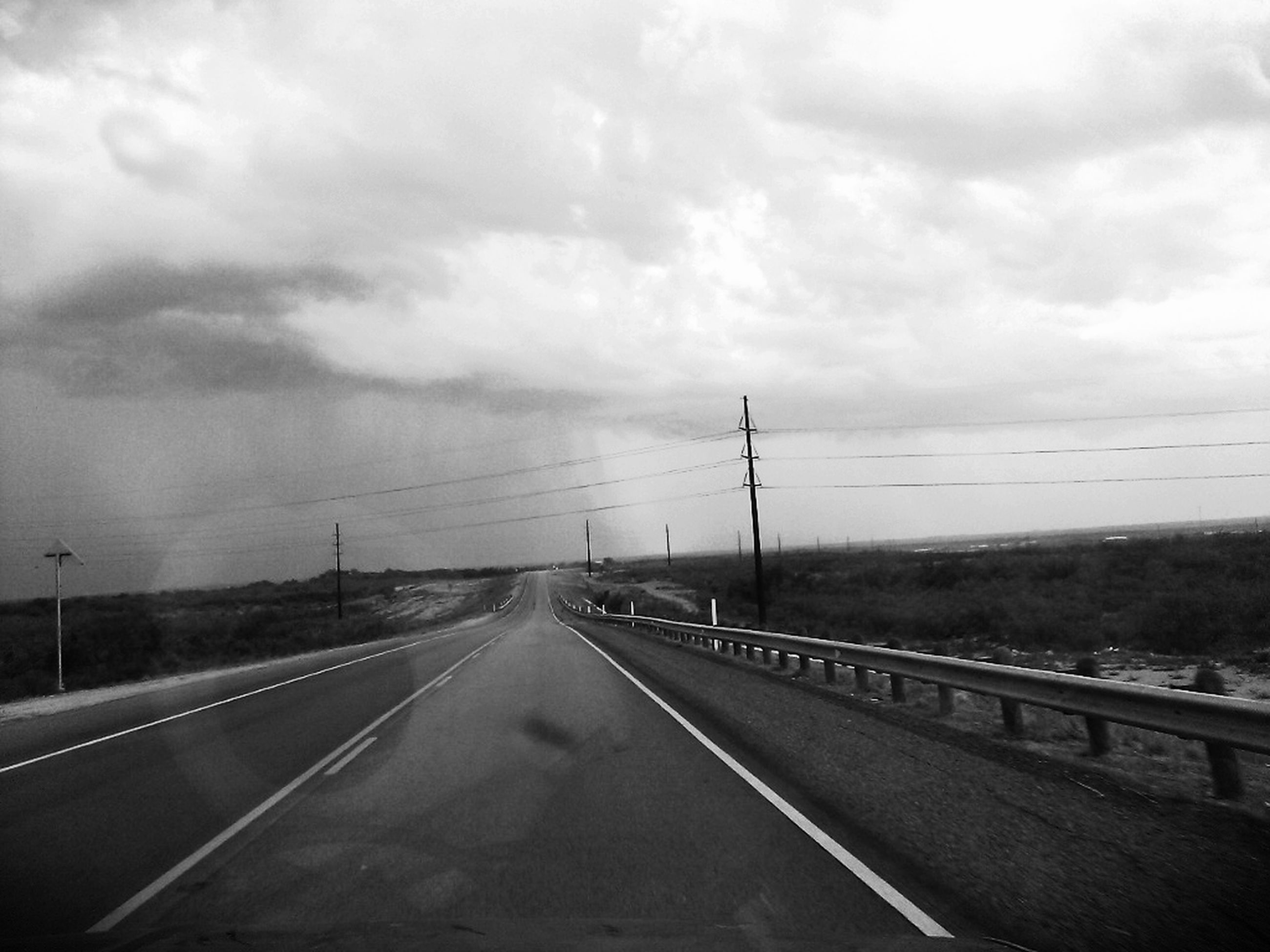 the way forward, transportation, road, sky, diminishing perspective, road marking, cloud - sky, vanishing point, cloudy, cloud, empty road, overcast, weather, highway, country road, empty, street, asphalt, landscape, nature