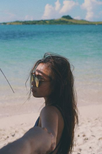 Side View Of Young Woman Wearing Eyeglasses At Beach