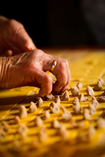 Tortellini Homemade Homemade Modena Body Part Chef Close-up Finger Food Food And Drink Freshness Hand Holding Human Body Part Human Hand Human Limb Indoors  Italian Food Making Occupation One Person Pasta Preparation  Preparing Food Selective Focus Table Tortellini