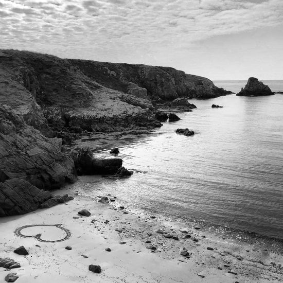 Ouessant - https://youtu.be/KwwwWz6Ef3I Blackandwhite Photography Blackandwhite Yanntiersen Ouessant Water Beach Sea Beauty In Nature Land Tranquility Rock Outdoors Sand No People Sky Rock Formation Nature