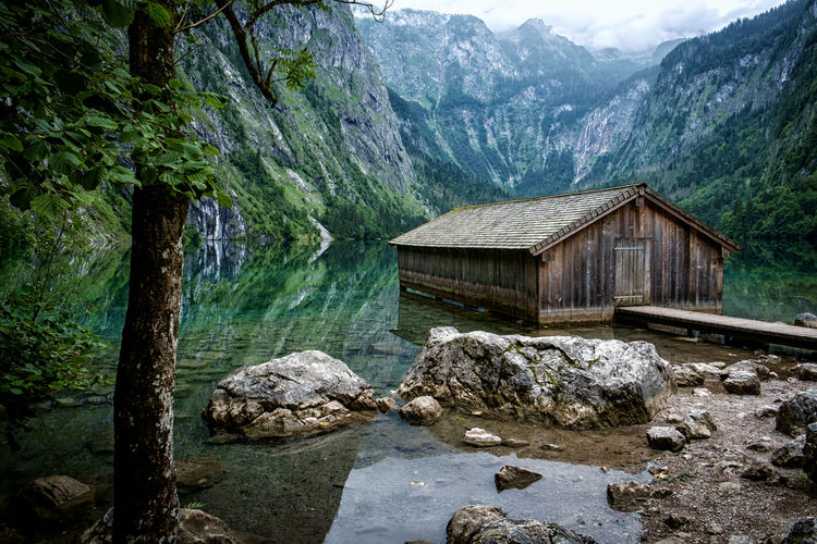 nice hut Königssee Obersee Alps Architecture Bavarian Alps Beauty In Nature Built Structure Day Flowing Water Mountain Mountain Range Nature No People Non-urban Scene Outdoors Plant Rock Rock - Object Scenics - Nature Solid Tranquil Scene Tranquility Tree Water