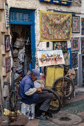Man sitting at market stall