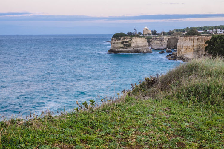 Architecture Beach Beauty In Nature Blue Cliff Coast History Horizon Over Water Italy Nature No People Outdoors Rock Formation Rocky Coast Rocky Coastline Salento Scenics Sea Sky Tourism Travel Travel Destinations Travel Photography Traveling Vacations