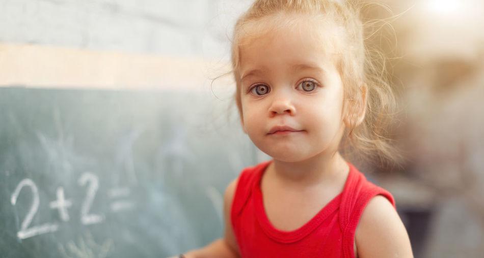 Portrait Of Cute Girl In School