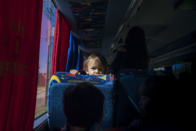 Portrait Of Boy Traveling In Bus