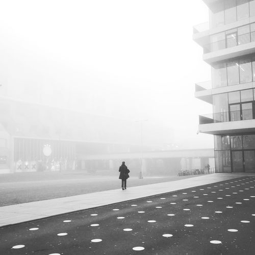 Full Length Fog Weather Only Men Walking Rear View One Person Outdoors Real People Day Silhouette One Man Only Men People Adult Adults Only Sky Amsterdam City Bicycle Rack Stationary City Life Building Exterior Film Photography Analogue Photography Kodak Moment