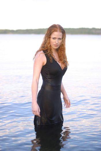 Portrait of woman standing in water
