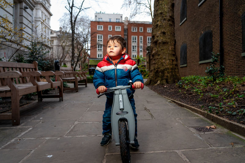 Portrait of boy on bicycle