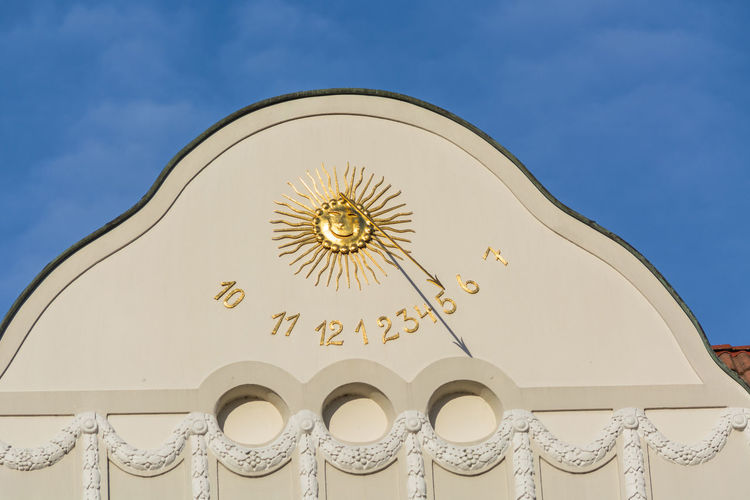 Sun Carving With Numbers On Building