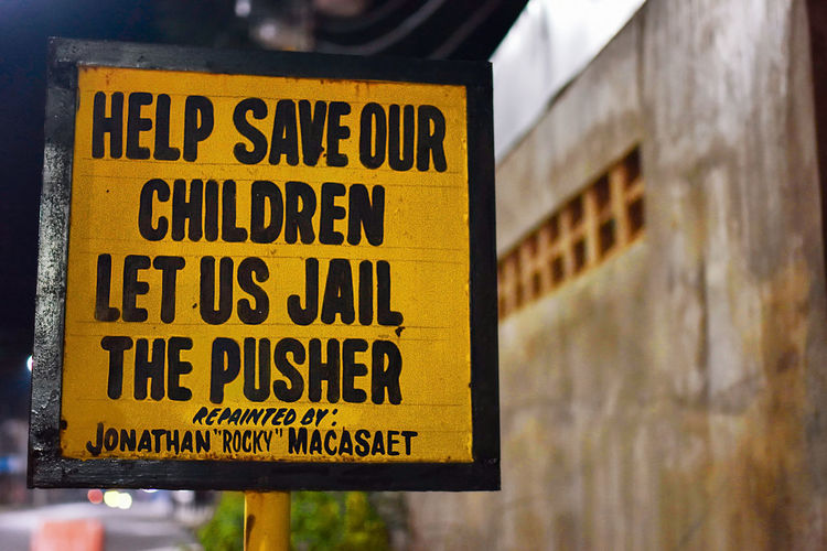 Duterte War on Drugs, Save our children hand painted street sign, Puerto Princesa, Philippines. Duterte Jail Philippines Sign Close-up Communication Day Drug Pusher Hand Painted No People Outdoors Pusher Save Our Children Street Sign Text War On Drugs Warning Warning Sign Yellow