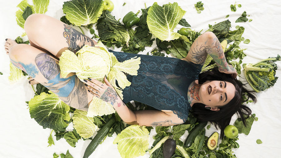 Day Freshness Girl Green Growth Happiness Healthy High Angle View Leaf Lifestyles Nature One Person Outdoors People Portrait Real People Smiling Tattoo Vegan Women Young Adult Young Women