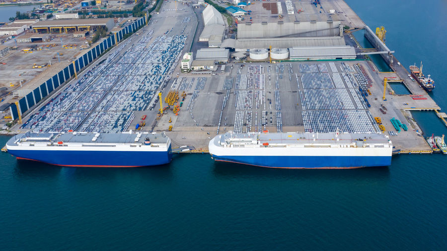 Aerial view car loading to large roro roll on off carrier vessel for shipping to worldwide.
