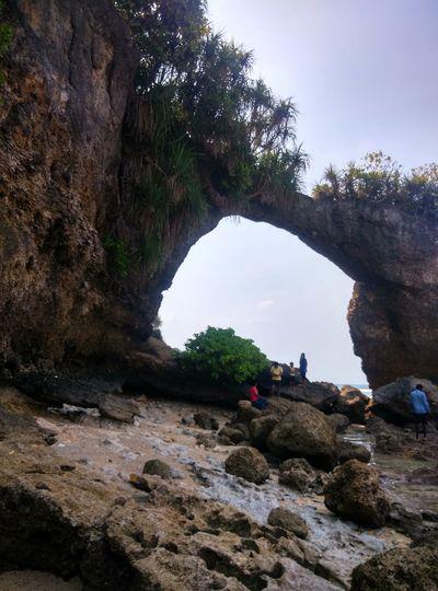 Natural bridge at beach took thounds of yearfor taking shape like bridge