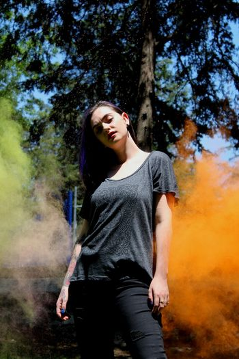 Pose. One Person Casual Clothing Three Quarter Length Front View Young Adult Standing People Young Women One Woman Only Adult Tree Outdoors Leisure Activity Only Women Day Human Body Part Adults Only One Young Woman Only Beauty Happiness Holi Arts Culture And Entertainment Ink Nature Tree