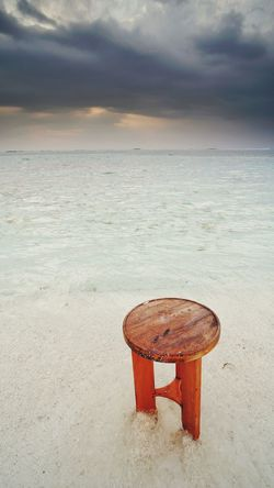Wooden chair on sandy beach of Maldives Maldives Seashore Seascape Maafushi Wooden Chair One Isolated Horizon Sea Breeze Sandy Sea Beach Red Water Sunset Business Finance And Industry Horizon Over Water Nature Tranquility Landscape Outdoors Sky Beauty In Nature Vacations No People Sand Relaxation Scenics Day City