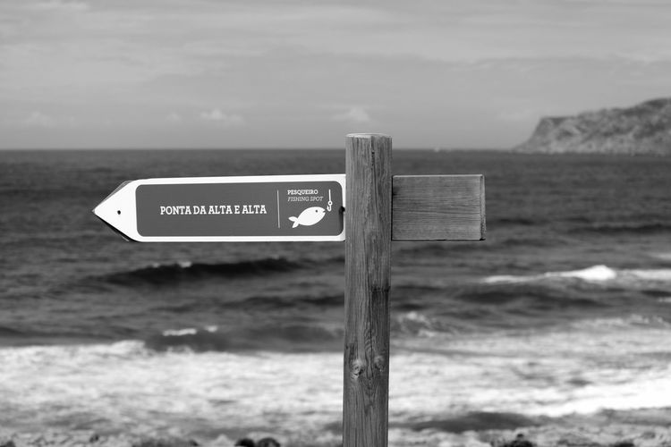 Sign Black & White Black And White EyeEm Blackandwhite Wooden Post Minimalism Beach Fishing Area Outdoors Blackandwhite Photography Bnw Eye4photography  EyeEm Best Shots EyeEm Bnw EyeEmBestPics Seaside Minimalobsession Beachphotography Fishing Area Directional Sign Minimal EyeEm Gallery Taking Photos Portugal