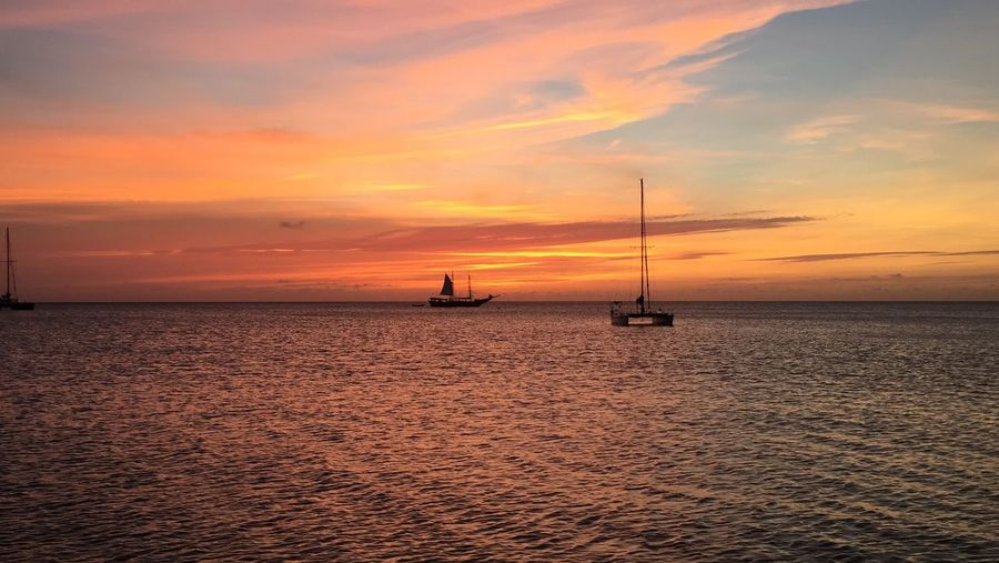 Sunset Water Sky Sea Cloud - Sky Nautical Vessel Beauty In Nature Orange Color Scenics - Nature Tranquil Scene Transportation Waterfront Horizon Over Water Sailboat Mode Of Transportation Horizon Tranquility Idyllic Silhouette No People