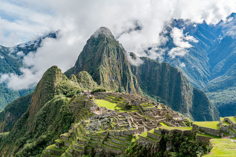 Archeology Machu Picchu Peru Ruins Travel Adventure Ancient Ancient Civilization Beauty In Nature Cloud - Sky Clouds Culture Day Famous Place History Majestic Mountain Mountain Range Nature Outdoors Scenics Sky Tranquil Scene Travel Destinations Tree
