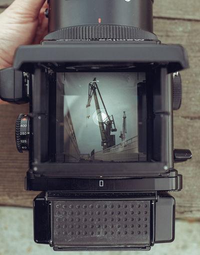 Close-up of hand photographing machine