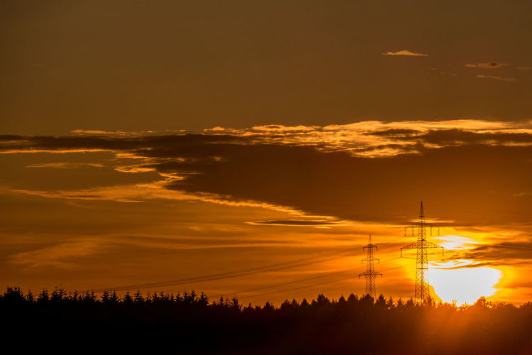 Sunset Sky Cloud - Sky Silhouette Orange Color Beauty In Nature Scenics - Nature No People Nature Tranquility Electricity  Tranquil Scene Technology Cable Dramatic Sky Non-urban Scene Electricity Pylon Idyllic Outdoors Connection Power Supply
