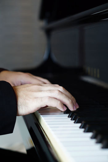 Music performer's hand playing the piano. (Close up) Arts Culture And Entertainment Finger Hand Human Body Part Human Hand Human Limb Indoors  Keyboard Keyboard Instrument Lifestyles Music Musical Equipment Musical Instrument Musician One Person Performance Piano Piano Key Playing Real People Selective Focus Skill  Unrecognizable Person