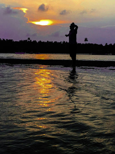 Sunset Silhouettes Sunset_collection Silhoutte Photography People Photography People On Beach Enjoying Life Feeling Happy Beach Photography Water Reflections Water_collection Evening Sky Setting Sun