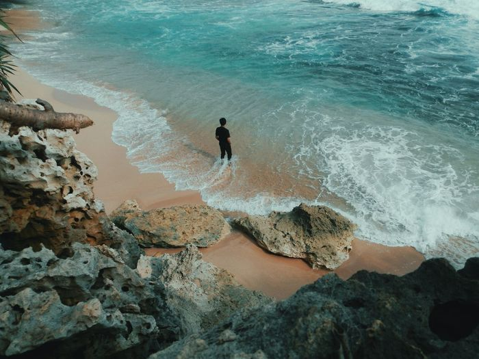 Without you Indonesia_photography EyeEm Selects Alone Jogja EyeEm Nature Lover EyeEm Nature Collection INDONESIA Natural Hobby Water Wave Sea Beach Sand High Angle View Ankle Deep In Water Surf Coast