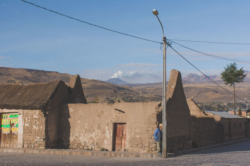 Architecture Blue Built Structure Cable Cloud Cloud - Sky Day Exterior Mountain Nature No People Outdoors Peru Pole Power Line  Residential Building Residential Structure Sky Smoking Volcano The Photojournalist - 2016 EyeEm Awards The Portraitist - 2016 EyeEm Awards Town Village Volcano Yanque