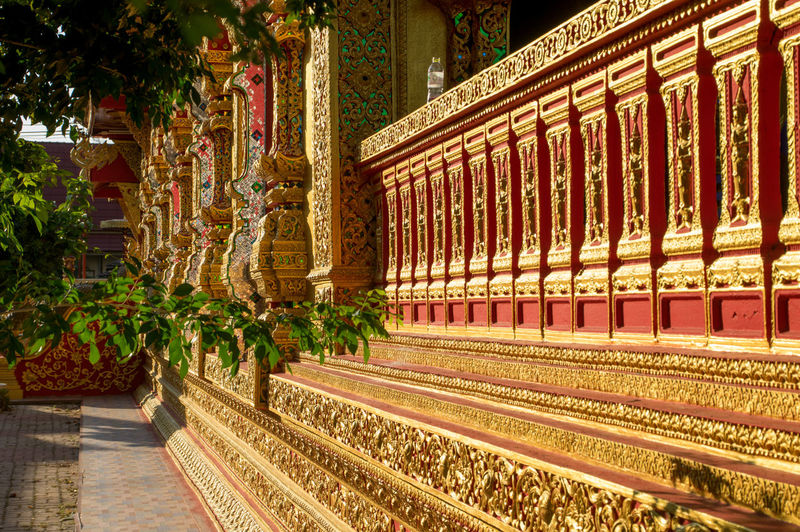 Buddhist temple in Lamphun Buddha Buddhist Temple Thailand Architecture Built Structure No People Religion Illuminated Building Belief Spirituality Building Exterior Nature Outdoors Place Of Worship Plant Day Lighting Equipment Track In A Row Rail Transportation Travel Destinations Architectural Column Luxury