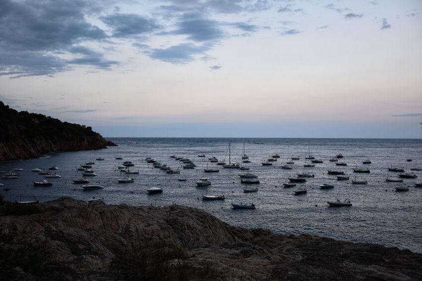 Boats anchored in the mediterranean coast in Tamariu Anchored Boats Catalonia Costa Brava Mediterranean  Mediterranean Coast Mediterranean Sea Tranquility Bay Boats Calm Sea Calm Water Sea Sea And Sky Sky Sunset Tamariu