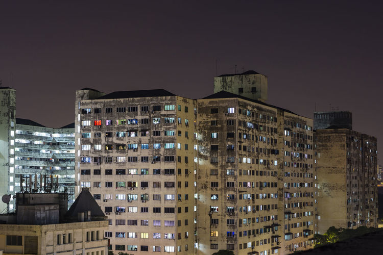 Low angle view of buildings against sky at night