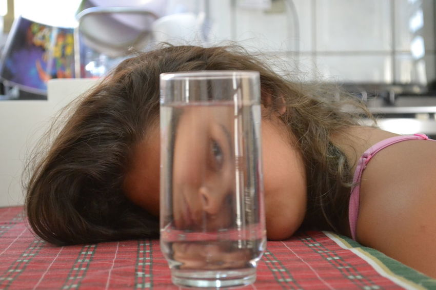 Faces Of EyeEm Hair Water Reflections Childhood Close-up Day Face Focus On Foreground Food And Drink Headshot Home Interior Indoors  Leisure Activity Lifestyles My Doughter One Person Popular Popular Photos Real People Sleepy Table Tired Water Young Adult Young Women