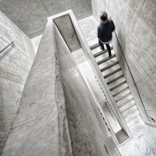 Concrete | Red box on the wall artist:DAX PHOTOGRAPHOHOLIC I born to capture | Concrete Concrete Staircase Kassel Stadtmuseum Kassel ArtistDAX Modernarchitecture Modern Architecture Walking Rear View Steps And Staircases High Angle View The Way Forward Real People Steps Staircase One Person Men Moving Up Indoors  Spiral Staircase Architecture