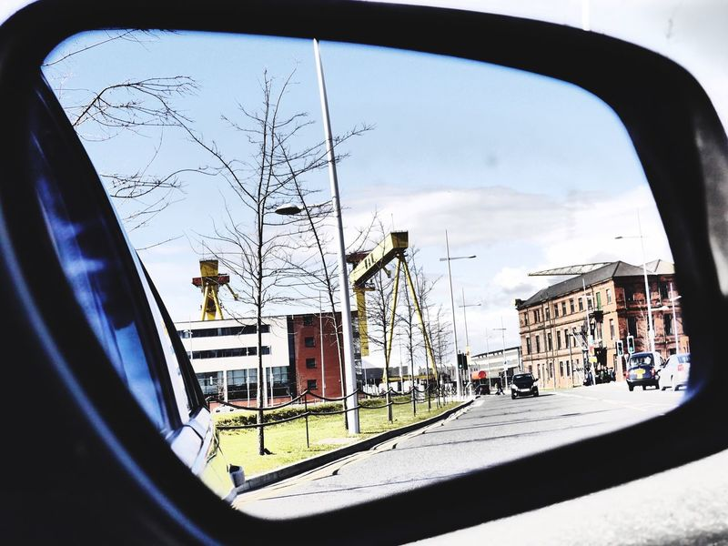 The Drive objects in the mirror Building Exterior Built Structure Transportation Bare Tree Architecture City Car Land Vehicle Day Outdoors Sky No People Belfast H&w Cranes Harland&Wolff Samson And Goliath Reflections Objects In Mirror Are Closer Than They Appear