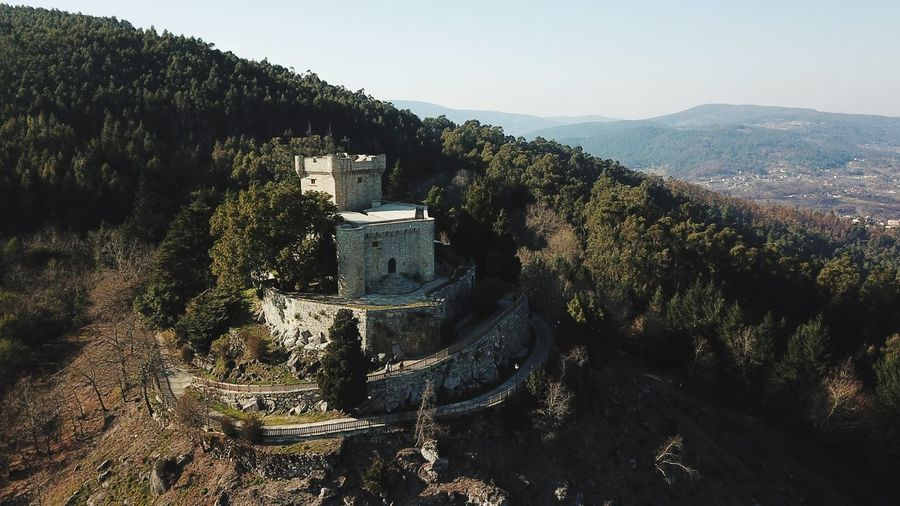 High angle view of castle on mountain against clear sky