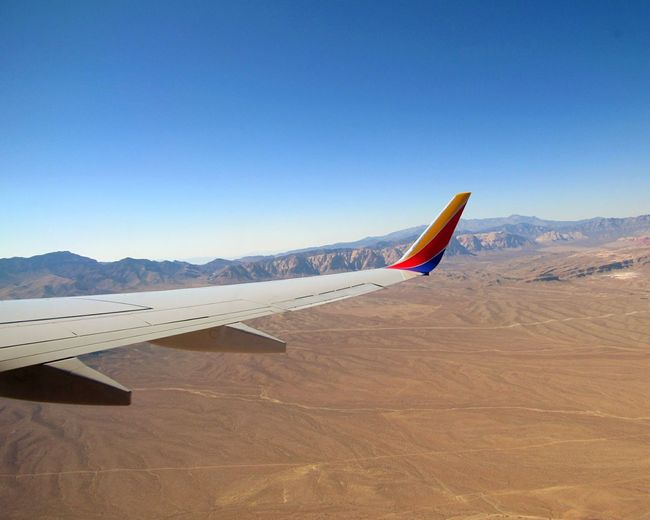 EyeEm Selects On Way To Las Vegas Nevada Mountain Sky Day Outdoors Clear Sky Sand Airplane Wing Airplane View Sport Desert Nature Innovation No People Beauty In Nature