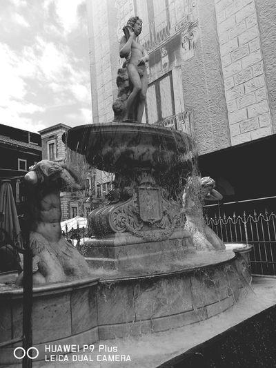 Catania in Love ❤ Fontana dell'Amenano #photography #street #love #streetphotography Amenano Fountain Catania Fountain Fountains History Historical Building Fiume Lago Spraying City Amusement Park Carousel Sky Building Exterior Street Art Drinking Fountain Fountain Sculpture Statue Sculpted Human Representation Water Slide