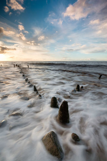 the remains of an old pier at Lilstock Beach, Somerset. Beach Beauty In Nature Cloud Cloud - Sky Fuji FUJIFILM X-T1 Groyne, Horizon Over Water Lilstock Motion Nature Rippled Rock - Object Scenics Sea Shore Sky Somerset South West UK Tranquil Scene Tranquility Water Waterfront Wave