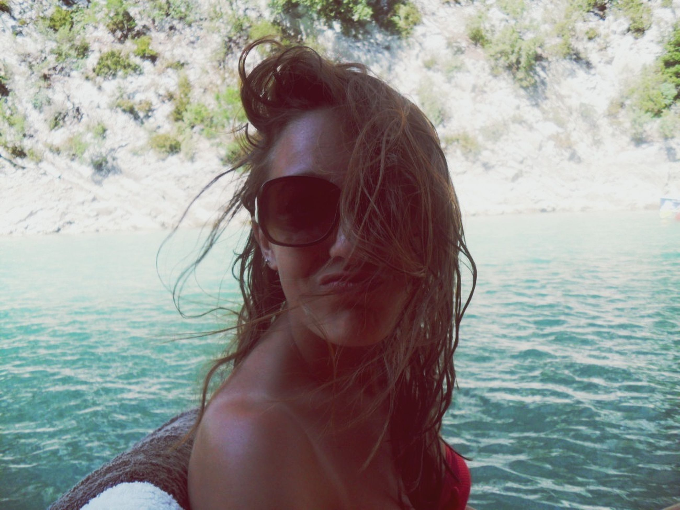 water, young adult, headshot, lifestyles, leisure activity, person, young women, long hair, sunglasses, sea, head and shoulders, vacations, portrait, looking at camera, blond hair, brown hair, day