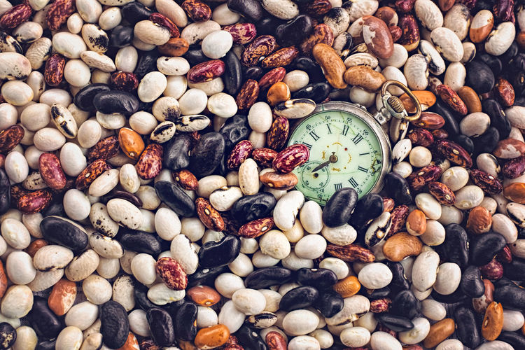 Close-up of watch in lentils