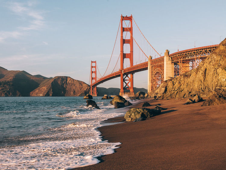 San Francisco Bridge on The Beach. Architecture Bay Of Water Beach Beauty In Nature Bridge - Man Made Structure City Cityscape Connection Day Mountain Nature No People Outdoors Rock - Object San Francisco San Francisco Bay Bridge Scenics Sea Sky Suspension Bridge Tourism Transportation Travel Travel Destinations Water Fresh On Market 2016