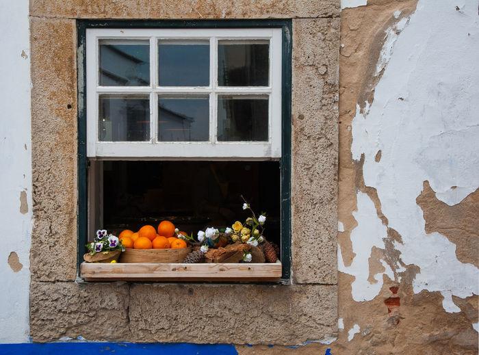Orange fruits on window of house