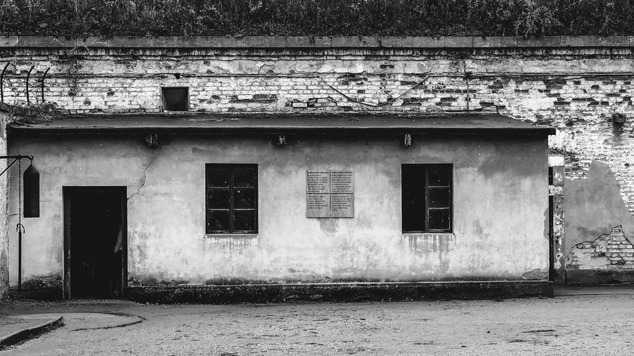 Abandoned Abandoned & Derelict Abandoned Buildings Abandoned Places Architecture Black & White Black And White Bradley Olson Bradleywarren Photography Building Exterior Built Structure Day Deterioration Monochrome PhotographyHistoric Monochrome No People Outdoors Prison Vintage Wall War Weathered Window Windows
